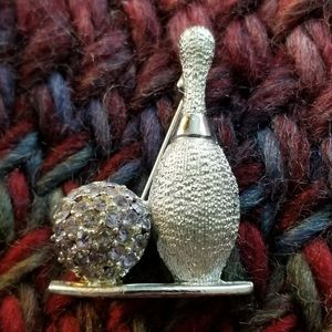 Vintage bowling pin brooch by Dodds silver tone